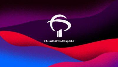 Ilustração em tons de roxo, vermelho, azul e rosa. No centro está o logo do banco Bradesco. Abaixo está escrito com a hashtag aliados pelo respeito em branco